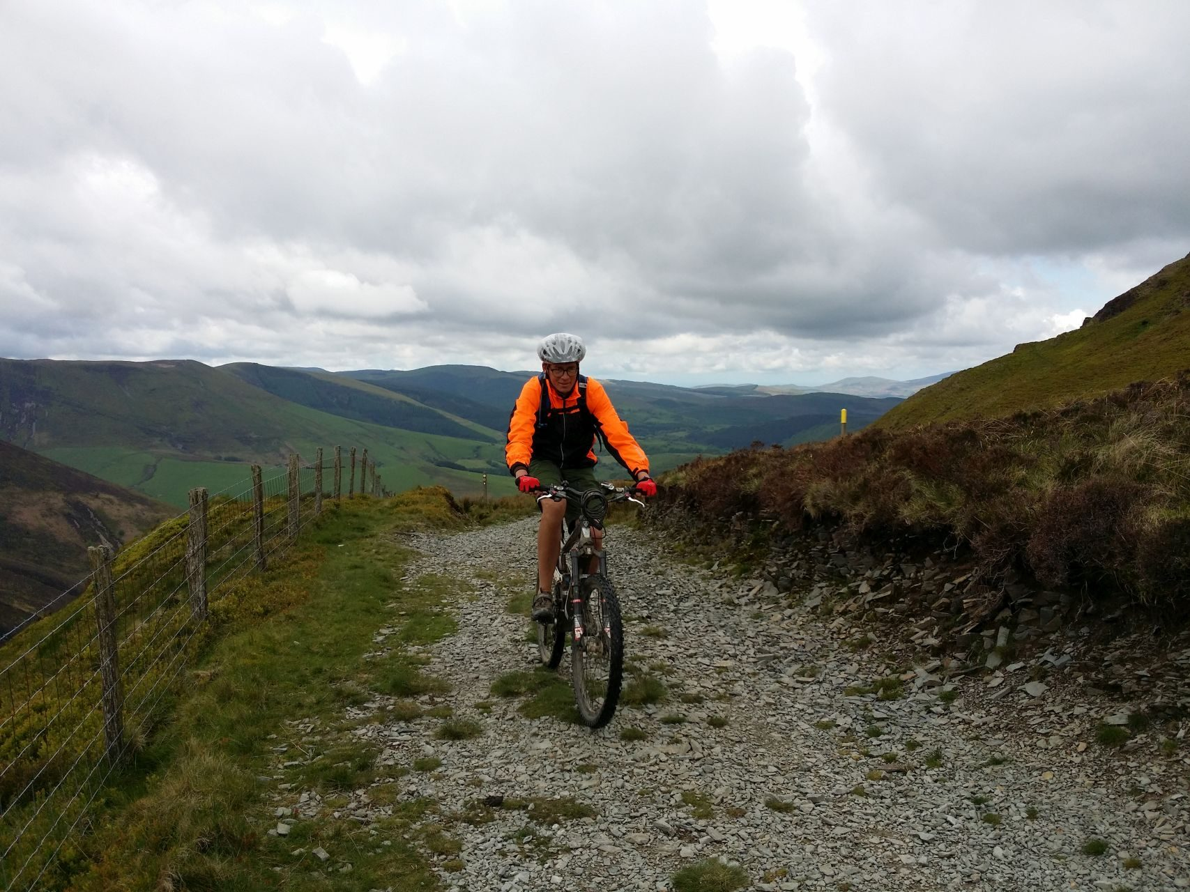 Day 4 - Paul riding up beneath slopes of Foel Fadian