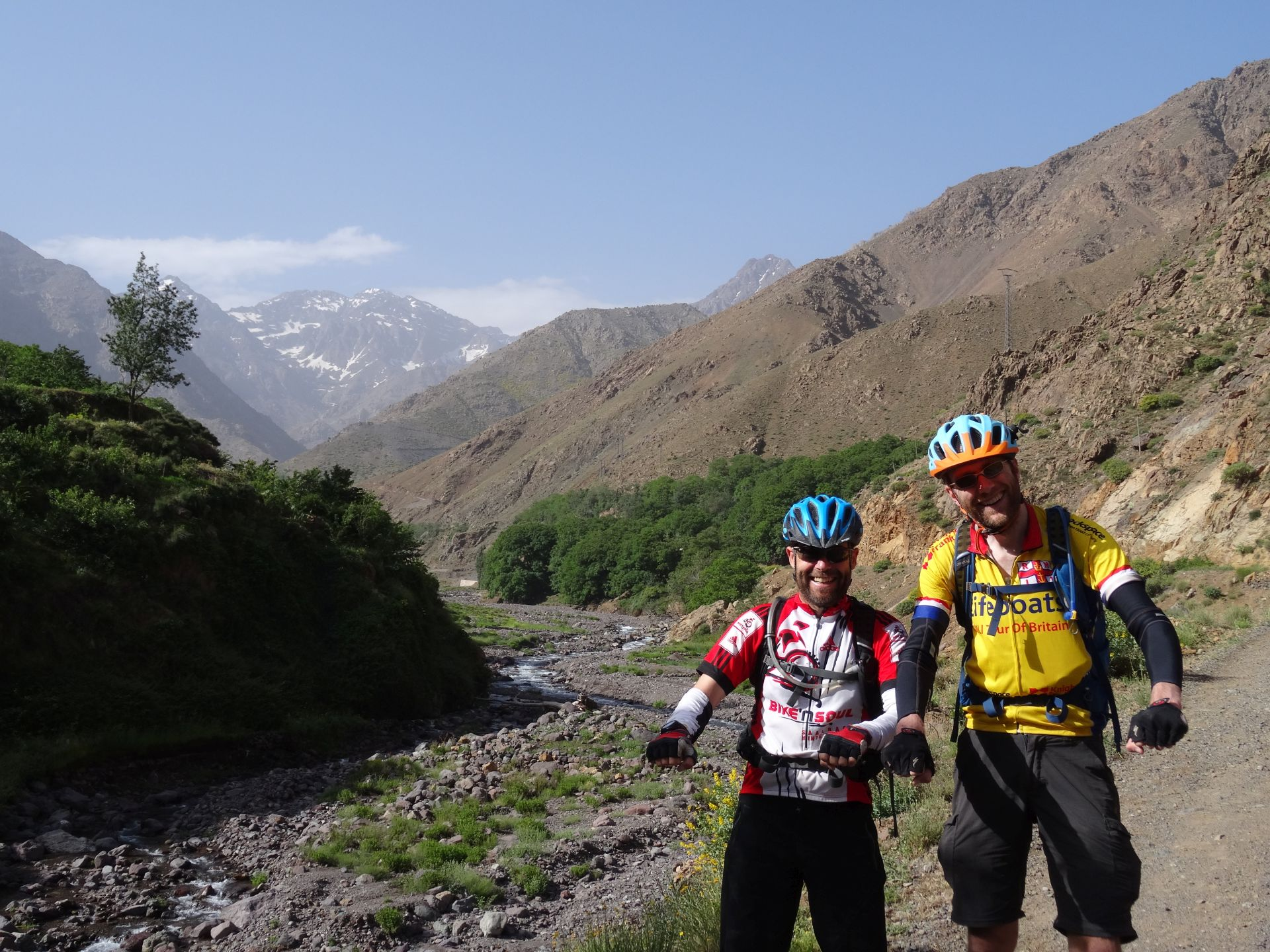 "Day 9 - It`s been a long two weeks on the road! We`re on our bikes, right? Right? ;) ""Riding"" beside the Oued Rheraya river, on the way back to Marrakesh. The mountain on the left is the highest peak in North Africa, Jbel Toubkal (13,671 ft). Crikey. © Steve Woodward"