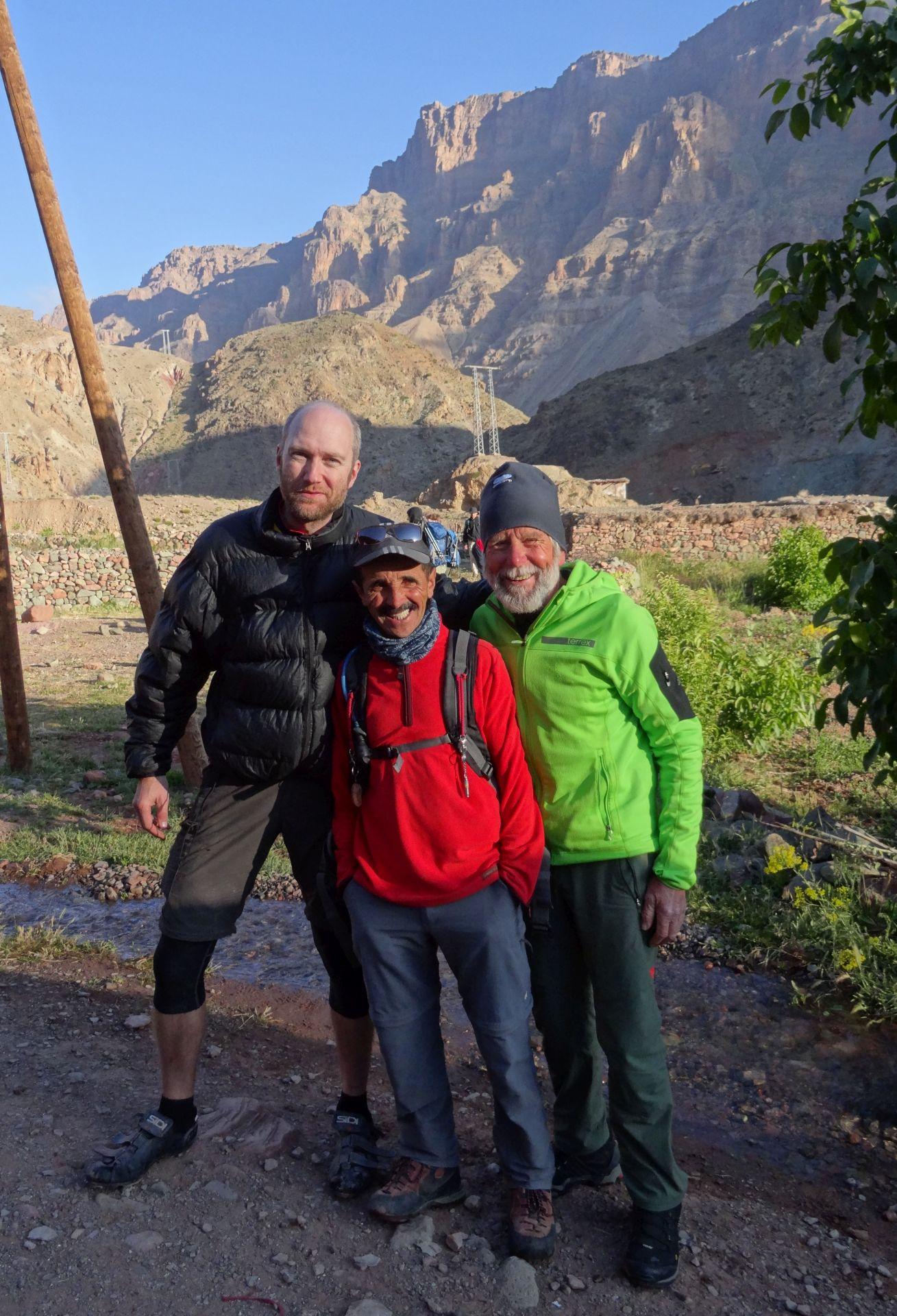 Day 4 - Guides for a trekking group, passing through: Brian (centre) & 74-year-old mountaineering legend, Siegfried Hupfauer (right) Near Ichbbakene, Tassaout valley. © Steve Woodward