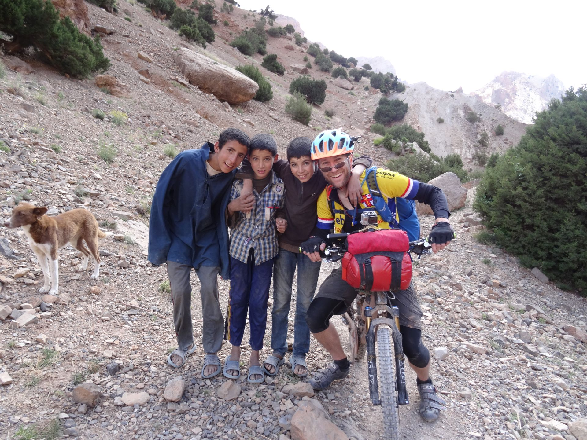 Day 5 - Our three little urchin friends, who show us a fantastic singletrack detour up into the hills, around the washed-away road. And their dog Max of course! Above Talat-n-Tazart. © Steve Woodward