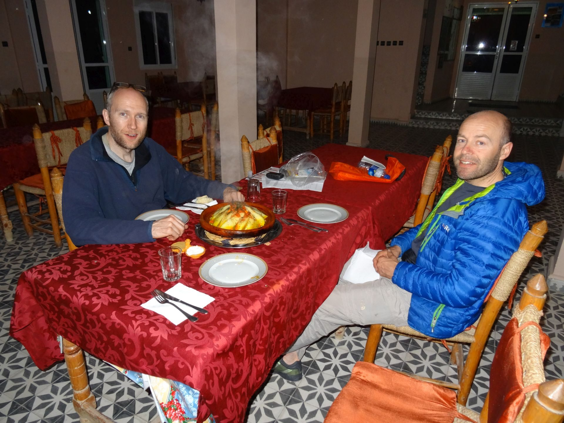 Transfer Day A  - Hungry boys Jon (left) & Shaun (right) ready themselves to inhale Tagine dinner before Steve puts camera down ... Hotel Izlane, Imilchil. © Steve Woodward