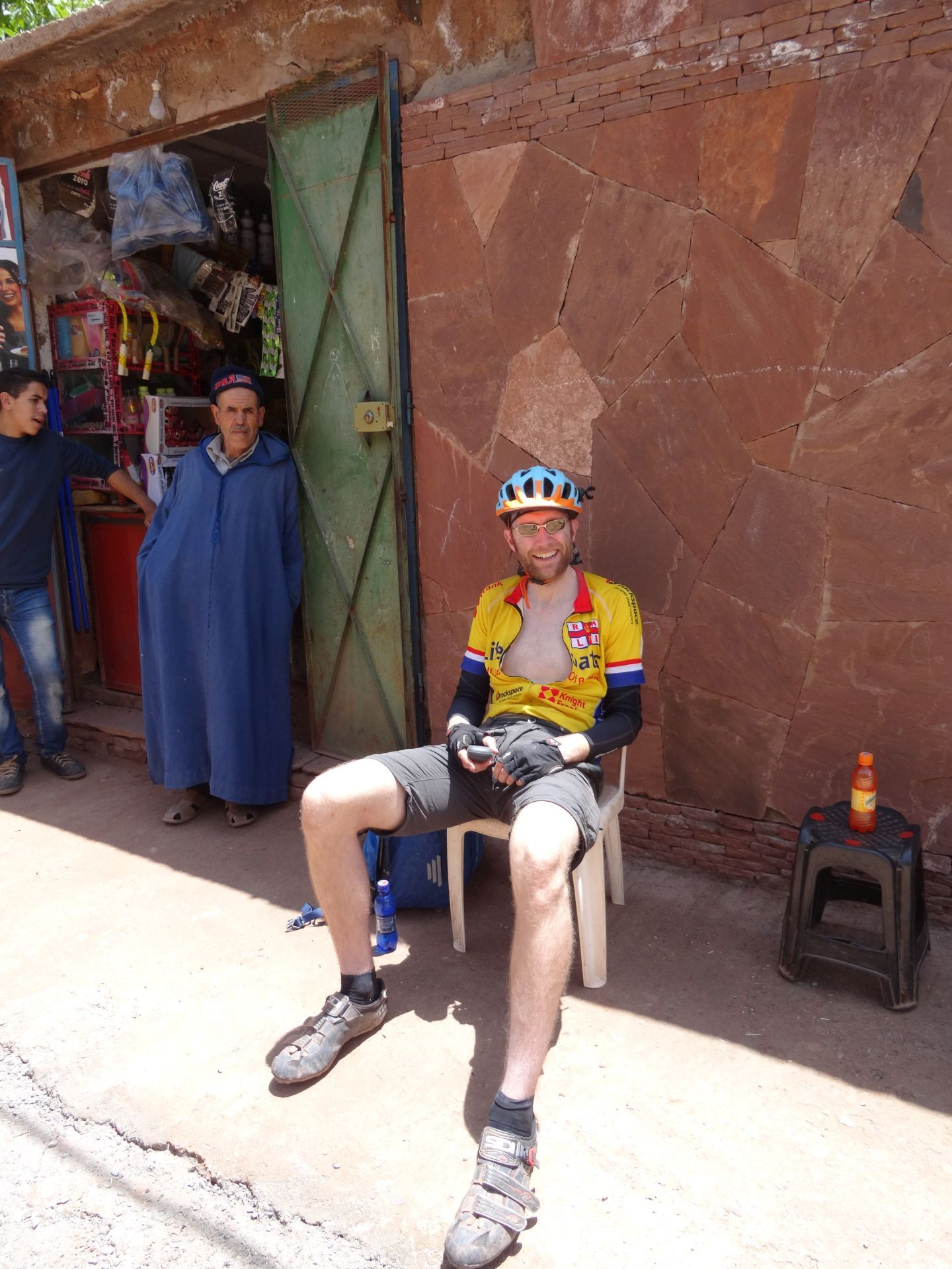 "Day 7- Resting up in the shade, readying to drink orange liquid sugar, during the steady 6-hour climb up the ""Ouka Monster"". © Steve Woodward"