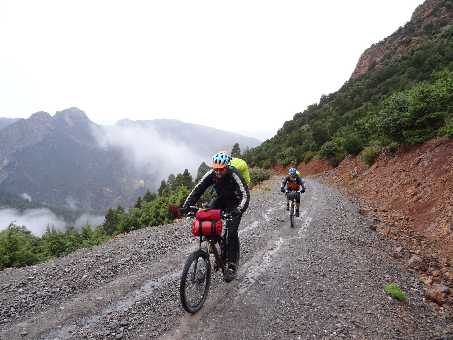 Day 2 - A really, really tough day on the bikes! The grind in the rain toward Zawyat Ahansal, & our accommodation for the night. © Steve Woodward