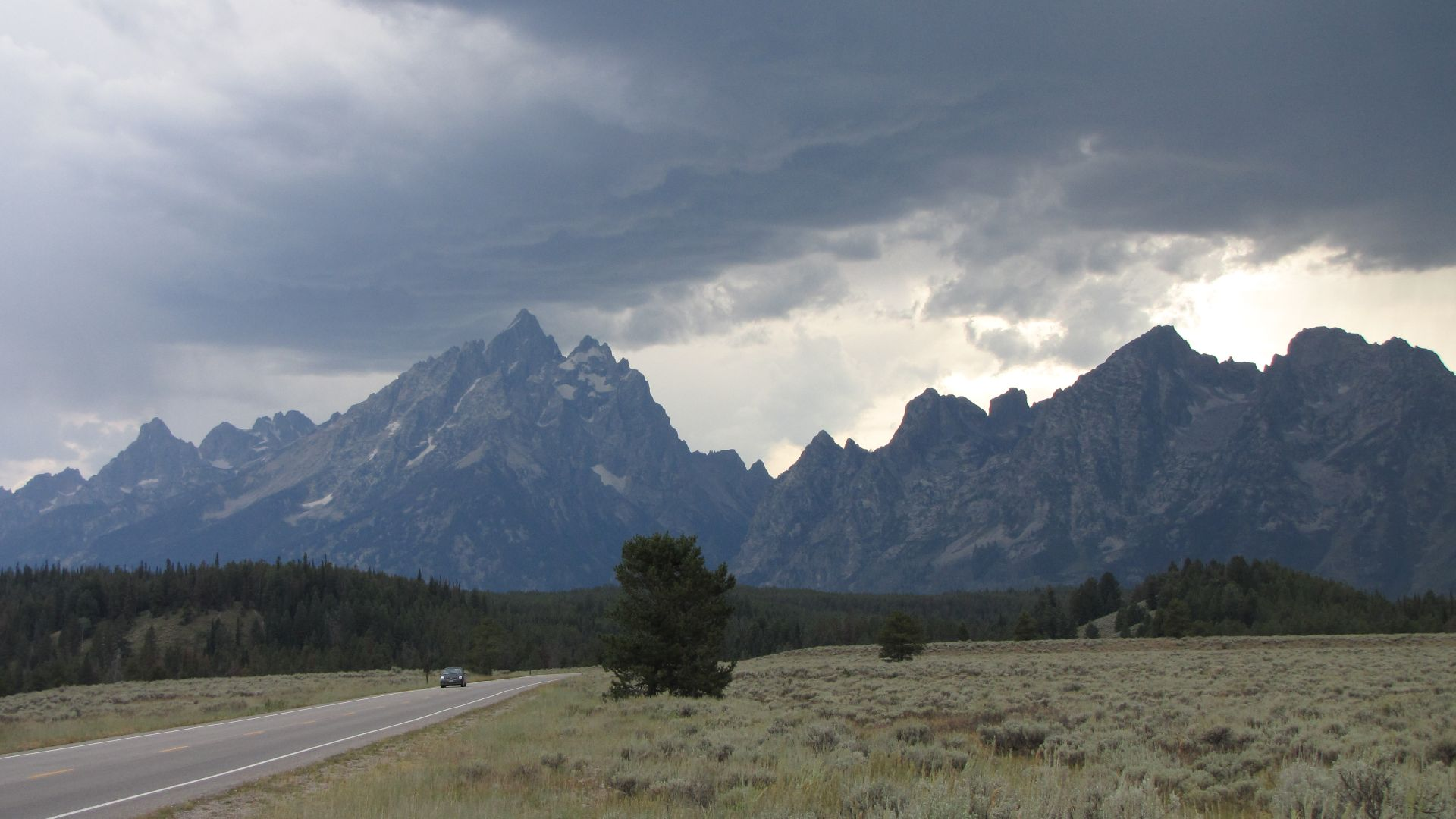 """The Teton mountains, Wyoming, USA during the rapid build-up to the mother of all thunderstorms & an urgent chase to get to camp. Taken during """"Part 1"""" of my 7-month solo  ride in 2009 from the Arctic Ocean coast to Mexico, later following the length of the Rocky Mountains"""