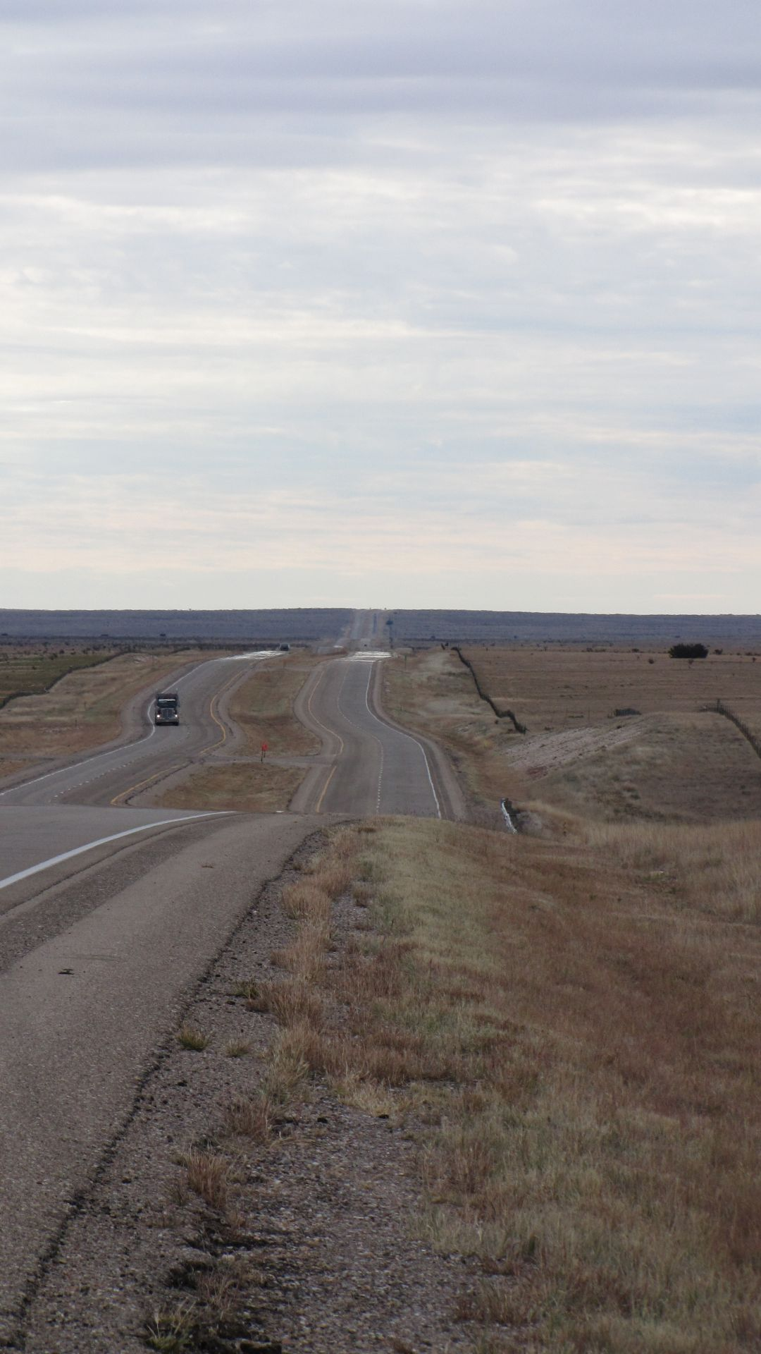 Nr Clines Corner, NM, USA - endless empty rolling hills with vast distances between towns through southern New Mexico